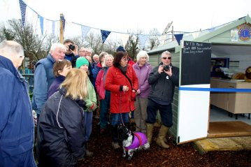 Members of the Community Farm assemble for the handover